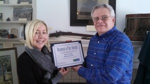 Loree Martin, Youth Specialist and Career Counselor from Finger Lakes Works – Yates County, presents the award to John Potter, Executive Director for the Yates County History Center.